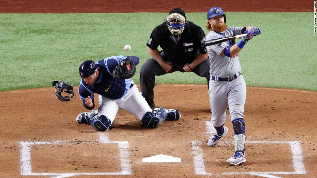 Rays catcher Mike Zunino is unable to field a wild pitch with Justin Turner of the Dodgers at the plate during the first inning.