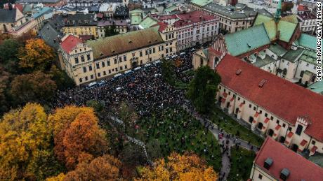 Thousands of protesters gathered during the fourth day of protests against the Constitutional Court ruling on tightening the abortion law in front of Krakow's Archbishop's Palace Sunday.