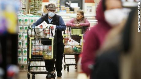 Seniors shop at Northgate Gonzalez Market on March 19 in Los Angeles. Storing extra groceries and other items is an important step in slowing the spread of the coronavirus.