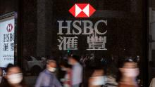 HSBC plans to speed up restructuring as profits drop 36%