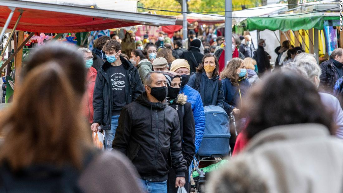 People shop at an outside market in Berlin on October 27.