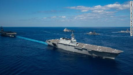 Japan's helicopter destroyer JS Kaga steams with the aircraft carrier USS Ronald Reagan during exercise Keen Sword 21.
