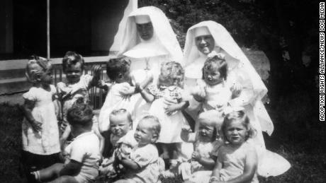 Nuns and babies are seen in this undated photo from the Bessborough mother and baby home.