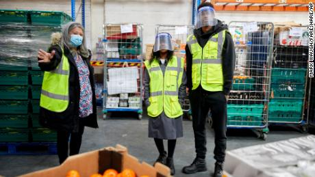 Rashford, right, and his mother Melanie, center, visit FareShare Greater Manchester at New Smithfield Market, Manchester, England, Thursday Oct. 22, 2020.