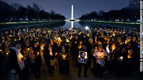 Holding candles and photos, friends and family gathered at the Lincoln Memorial to remember Bijan Ghaisar.