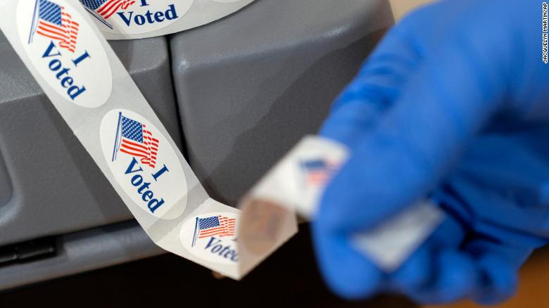 Federal judge sets hearing Monday on challenge to ballots from drive-thru voting in Texas' largest county