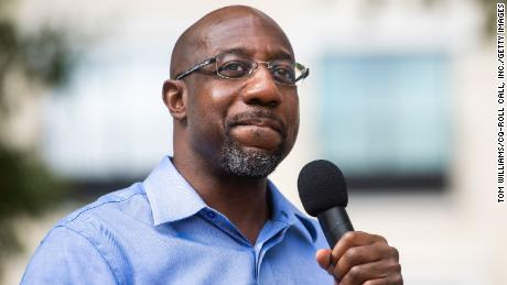 Reverend Raphael Warnock, then a Democratic candidate for the US Senate, speaks during a 2020 campaign rally in LaGrange, Georgia.