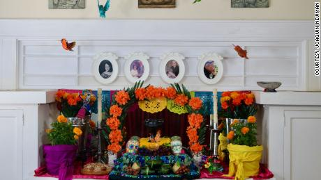 Evelyn Orantes and Joaquin Newman make an altar for their ancestors every year in their home.