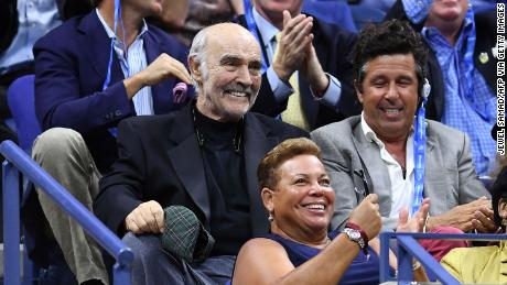 Connery, center, watches a 2017 US Open Men's Singles match in New York on August 29, 2017.