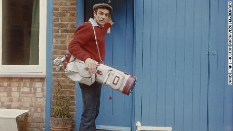 Connery sets off for a game of golf in August 1962.