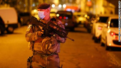 A French soldier stands guard after the incident in Lyon on Saturday.