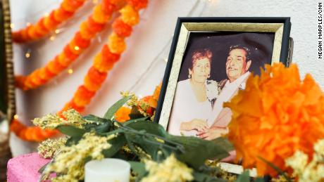 The ofrenda at Tres Leches Café has a photo of Magaly Saenz's partner's grandparents. The grandfather has passed away, but the grandmother is still alive.