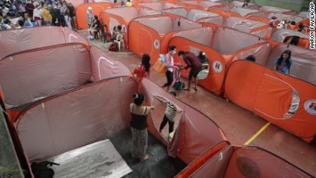Residents occupy an evacuation center as rains start to pour in Manila, Philippines on Sunday.