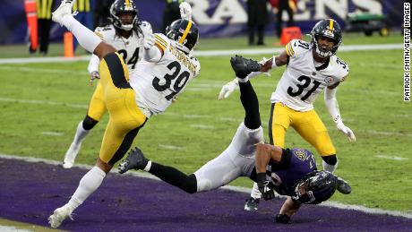 Free safety Minkah Fitzpatrick #39 and cornerback Justin Layne #31 of the Pittsburgh Steelers hit wide receiver Willie Snead #83 of the Baltimore Ravens on the last play of the game during the Steelers 28-24 win.