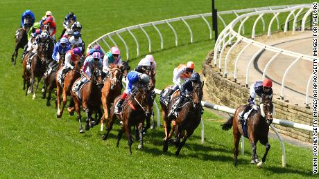 Twilight Payment leads the field around the first bend at the 2020 Melbourne Cup.