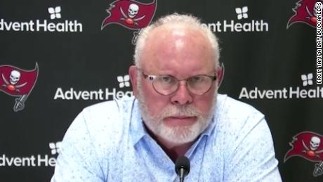 Arians speaks at a press conference.