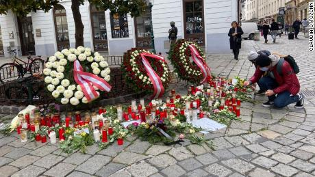 Wreaths, flowers and candles are left on Judengasse in Vienna on Wednesday.