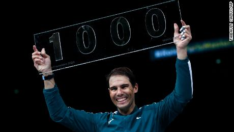 Nadal poses with the trophy of his 1000th victory.