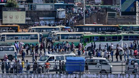 Passengers queue to get on buses in Addis Ababa, Ethiopia on  November 6.