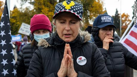 Supporters of President Donald Trump pray during a rally to protest against President-elect Joe Biden's win Saturday, Nov. 7, 2020 in Salem, Ore.