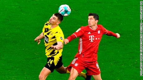 "Dortmund's Thomas Meunier, left, and Bayern's Robert Lewandowski challenge for the ball during ""Der Klassiker."""
