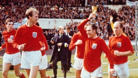 Jack Charlton (left) and his brother Bobby (right) celebrate England's 1996 World Cup final win.