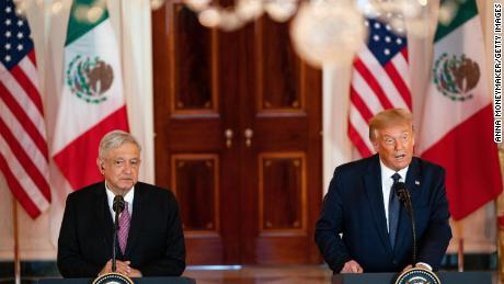 Trump and López Obrador address the media at the White House in July.