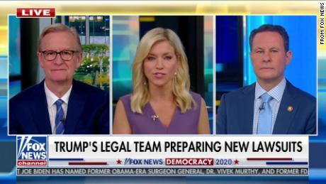 "A screenshot of the Fox News show ""Fox and Friends."""