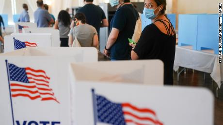 ATLANTA, GA - JUNE 09: People wait in line to vote in Georgia's Primary Election on June 9, 2020 in Atlanta, Georgia. Voters in Georgia, West Virginia, South Carolina, North Dakota, and Nevada are holding primaries amid the coronavirus pandemic. (Photo by  Elijah Nouvelage/Getty Images)