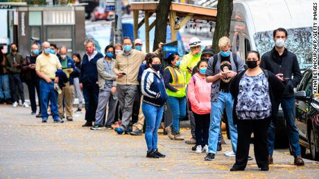 People line up outside a Covid-19 testing site in New York on November 11, 2020. - The novel coronavirus has killed at least 1,275,113 people since the outbreak emerged in China last December, according to a tally from official sources compiled by AFP at 1100 GMT on Wednesday. At least 51,531,660 cases of coronavirus have been registered. Of these, at least 33,300,900 are now considered recovered. (Photo by Kena Betancur / AFP) (Photo by KENA BETANCUR/AFP via Getty Images)
