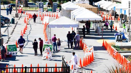 People wait in line to be tested at a Covid-19 test site in Los Angeles on November 10, 2020