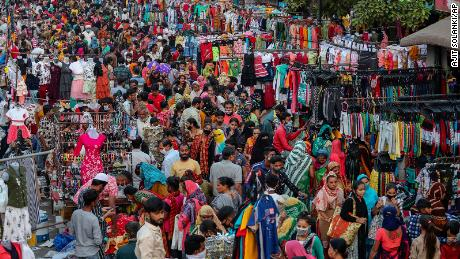 Indians throng a market for shopping ahead of Hindu festival Diwali in Ahmedabad, India, on Novermber 9, 2020.