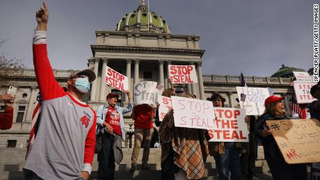 Dozens of people calling for stopping the vote count in Pennsylvania due to alleged fraud against President Donald Trump gather on the steps of the State Capitol on November 5 in Harrisburg, Pennsylvania.