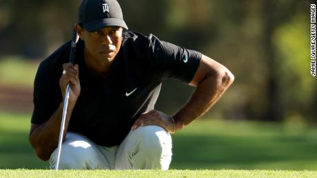 Tiger Woods of the United States lines up a putt on the third green during the second round of the Masters.