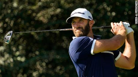 Dustin Johnson watches his tee shot on the 14th hole during the second round of the Masters golf tournament.