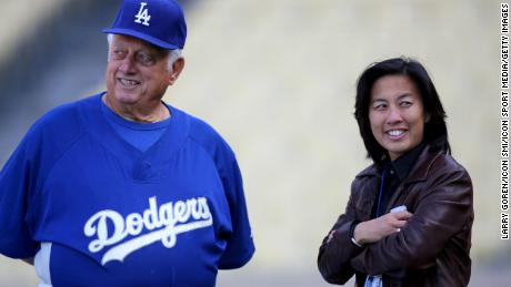 Former Dodgers Manager Tommy Lasorda talks with then-Assistant General Manager Kim Ng.