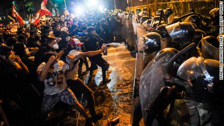 Dozens wounded in Peru as protesters and police clash amid political crisis