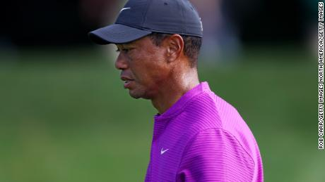A pensive Tiger Woods walks off the eighth green on his way to a level-par 72 to leave him off the pace in his defense of the title at Augusta.
