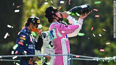 Lance Stroll (derecha) celebra en el podio en el GP de Italia de este año.