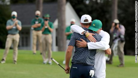 Johnson celebrates with his brother and caddie Austin.