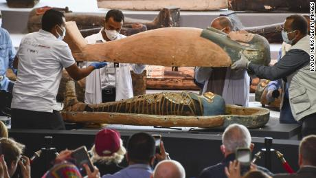 Archaeologists find 100 ancient Egyptian coffins, some with mummies, at burial complex