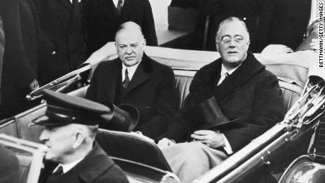 On the day of Franklin Delano Roosevelt's presidential inauguration in 1933, he rides with his predecessor Herbert Hoover to the ceremony.
