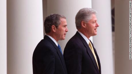 President Bill Clinton and President-elect George W. Bush stand outside the White House for their first meeting since the election December 19, 2000, a Washington, D.C.
