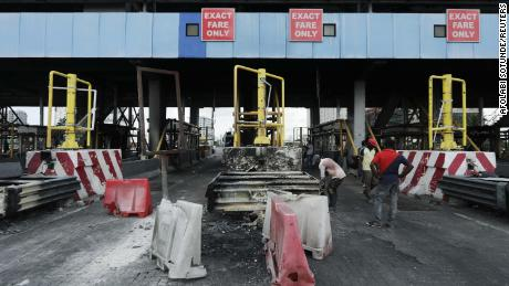 Workers clean up the Lekki toll gate on October 24.