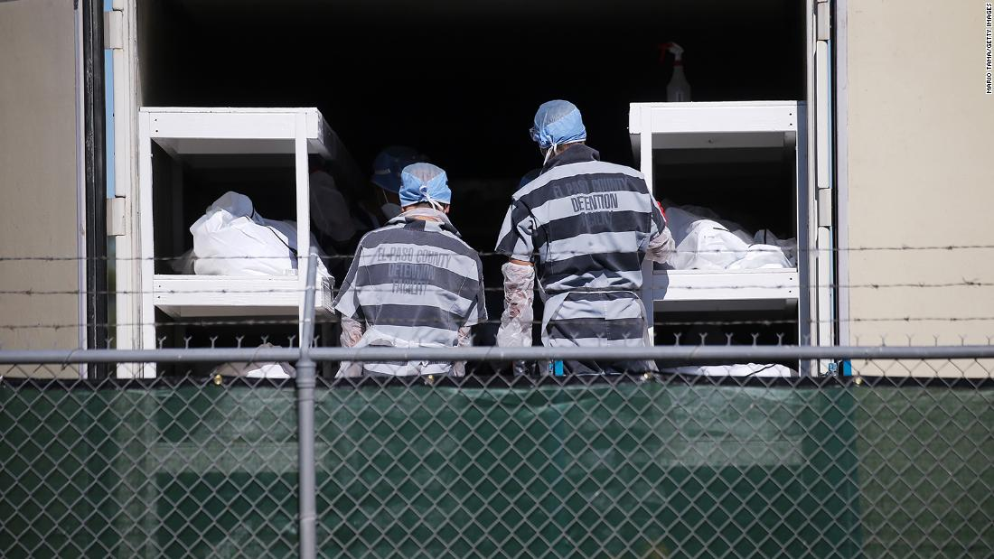 "Inmates from the El Paso County detention facility load bodies into a refrigerated trailer at the El Paso County Medical Examiner's Office in Texas on November 16. The inmates were <a href =""https://www.cnn.com/2020/11/16/us/el-paso-inmate-covid-bodies-trnd/index.html"" target =""_blank&ampquott;>temporarily relieving overworked personnel</un> at the office."