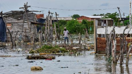An inhabitant of the Nuevo Paraiso neighborhood on the island of Belen walks on a flooded area after the passage of Hurrican Iota.