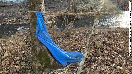 The creekbed and tarp where Jordan Gorman was found, about three-quarters of a mile from his home.