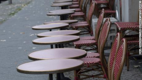 Empty tables and chairs stand in front of a restaurant in Berlin. Germany is under partial lockdown in November.