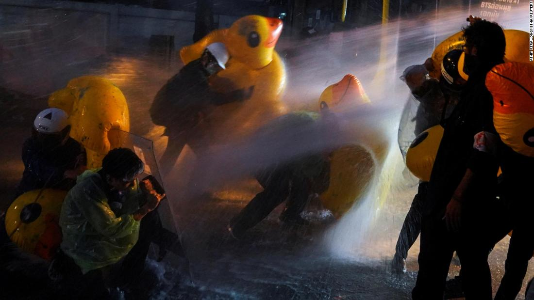 Demonstrators use inflatable rubber ducks as shields to protect themselves from water cannons during a demonstration outside the parliament in Bangkok, as lawmakers debate constitutional changes, on November 17.