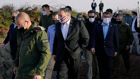 Pompeo, center, arrives for a security briefing on Mount Bental in the Golan Heights on November 19.